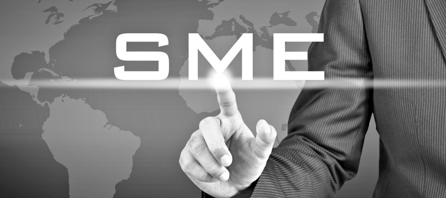 Businessman hand touching SME(or Small and Medium Enterprise) sign on virtual screen - commercial & business concept
